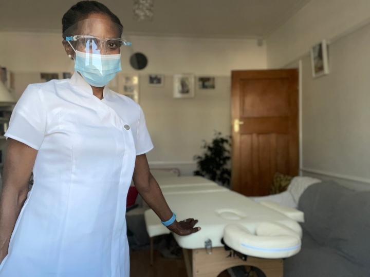 As of May 2021, PPE mask and shield being worn during Reiki sessions. Photo with Patricia Foster McKenley, YouAreYOU.co Reiki Therapist.
